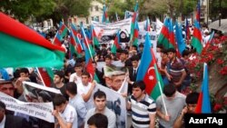 Azerbaijanis rally in front of the Iranian Embassy in downtown Baku on May 11.