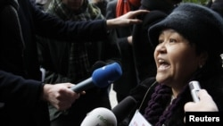 President Islam Karimov's iron grip on the country has forced many critics of his administration, including Mutabar Tajibaeva, seen here protesting in front of the European Commission in Brussels in January, to voice their grievances abroad or not at all.