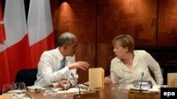 Прэзыдэнт ЗША Барак Абама (зьлева) і канцлер Нямеччыны Ангела Мэркель