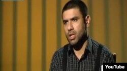 Fərid Hüseynin istintaq zamanı dindirilməsi kadrlarını İranın PressTV kanalı göstərir.