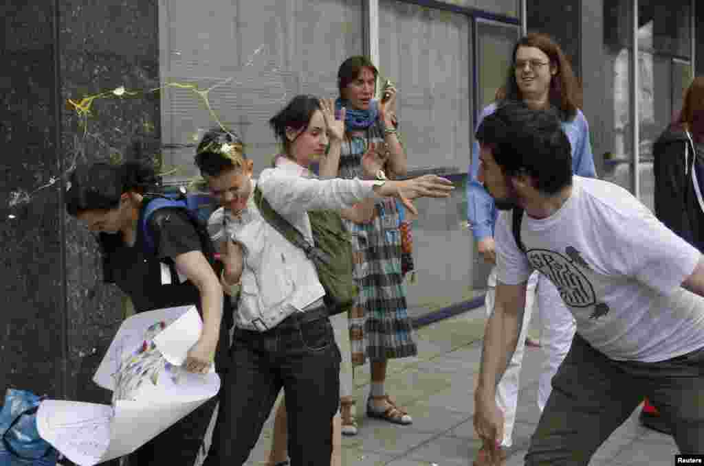 "An egg splatters over young gay-rights activists after an attempted ""kiss-in"" in front of the Russian parliament in Moscow in 2013. Vladimir Putin himself has maintained a publicly benign attitude to Russia's LGBT community and has repeatedly claimed Russia does not discriminate against gays."
