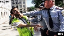 Aliyev is beaten by police at a protest rally in Baku in June 2013.