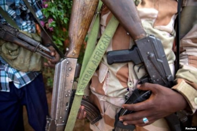 An armed fighter belonging to the 3R rebel group displays his weapon in the town of Koui in the Central African Republic in 2017. The country has been riddled by violence since a 2013 rebellion overthrew then-President Francois Bozize.