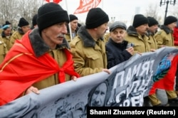 Participants, including veterans of the military campaign, march during a ceremony marking the 30th anniversary of the withdrawal of Soviet troops from Afghanistan in Moscow on February 15.