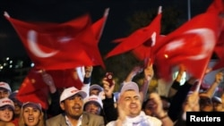 Turkey -- Supporters of Prime Minister and leader of ruling Justice and Development Party cheer in front of the Party building in Istanbul, 12Sep2010