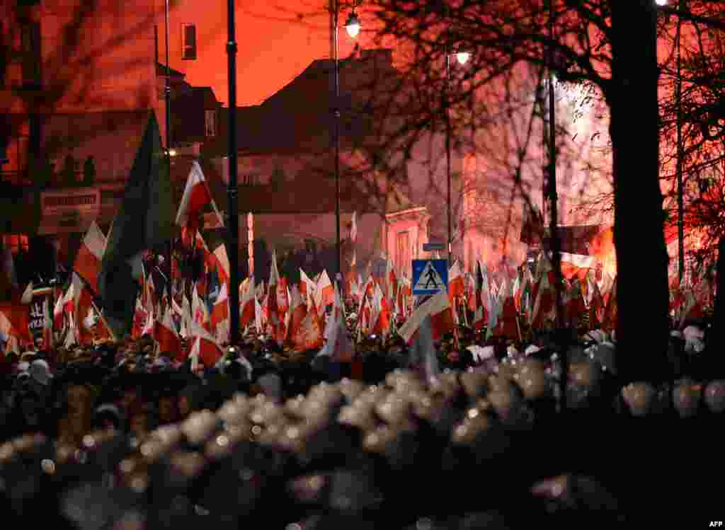 Far-right protesters walk past the Russian Embassy during their annual march, which coincides with Poland's national Independence Day in Warsaw. (AFP/Janek Skarzynski)