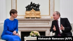 Russian President Vladimir Putin meets with his Estonian counterpart Kersti Kaljulaid at the Kremlin in Moscow on April 18.