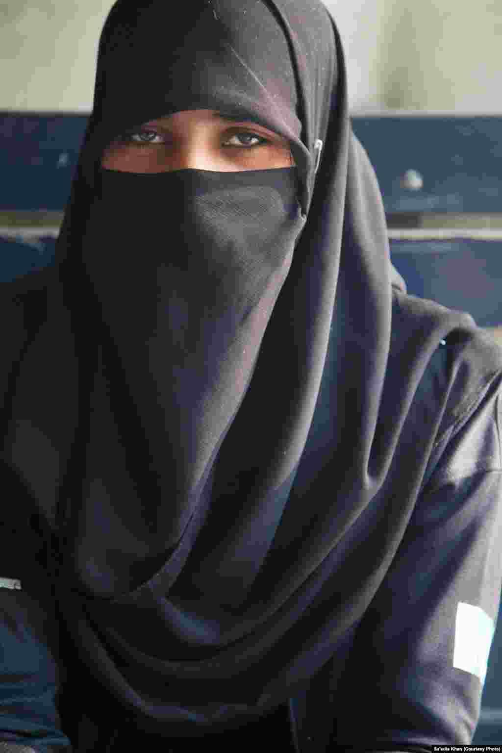A female police commando wearing Niqab, a full Islamic veil.
