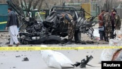 Afghan security forces inspect the site of a bomb blast in Kabul on February 20.
