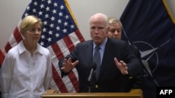 U.S. Senators Elizabeth Warren (left), John McCain (center), and Lindsey Graham speak to the press in Kabul on July 4.