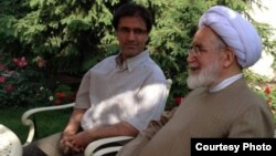 Mehdi Karrubi (right) visits with his son, Mohammad Hossein Karrubi in Tehran on June 4.