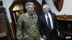 U.S. Defense Secretary Jim Mattis (right) and U.S. Army General John Nicholson, commander of U.S. forces in Afghanistan, in Kabul on April 24