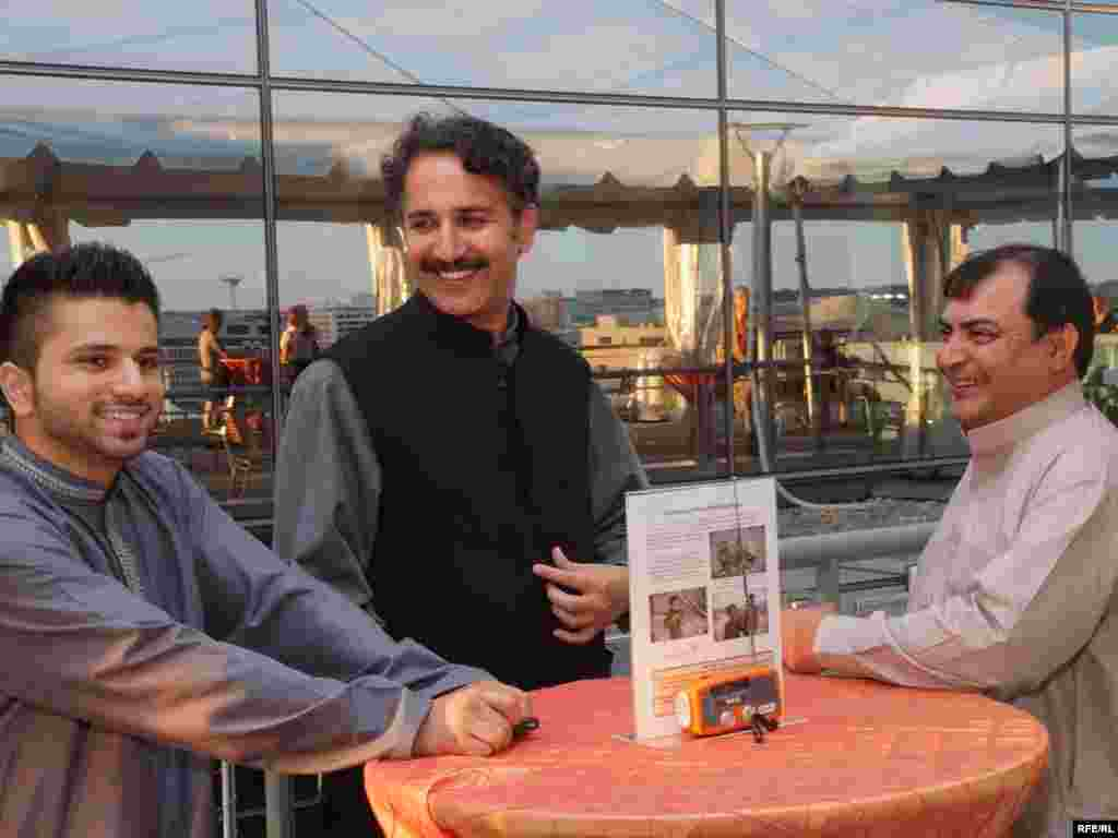 Radio Mashaal broadcaster and popular Pashtun folk singer Haroon Bacha and fellow musicians enjoy the view from the Newseum at RFE's 60th anniversary celebration in Washington, DC.