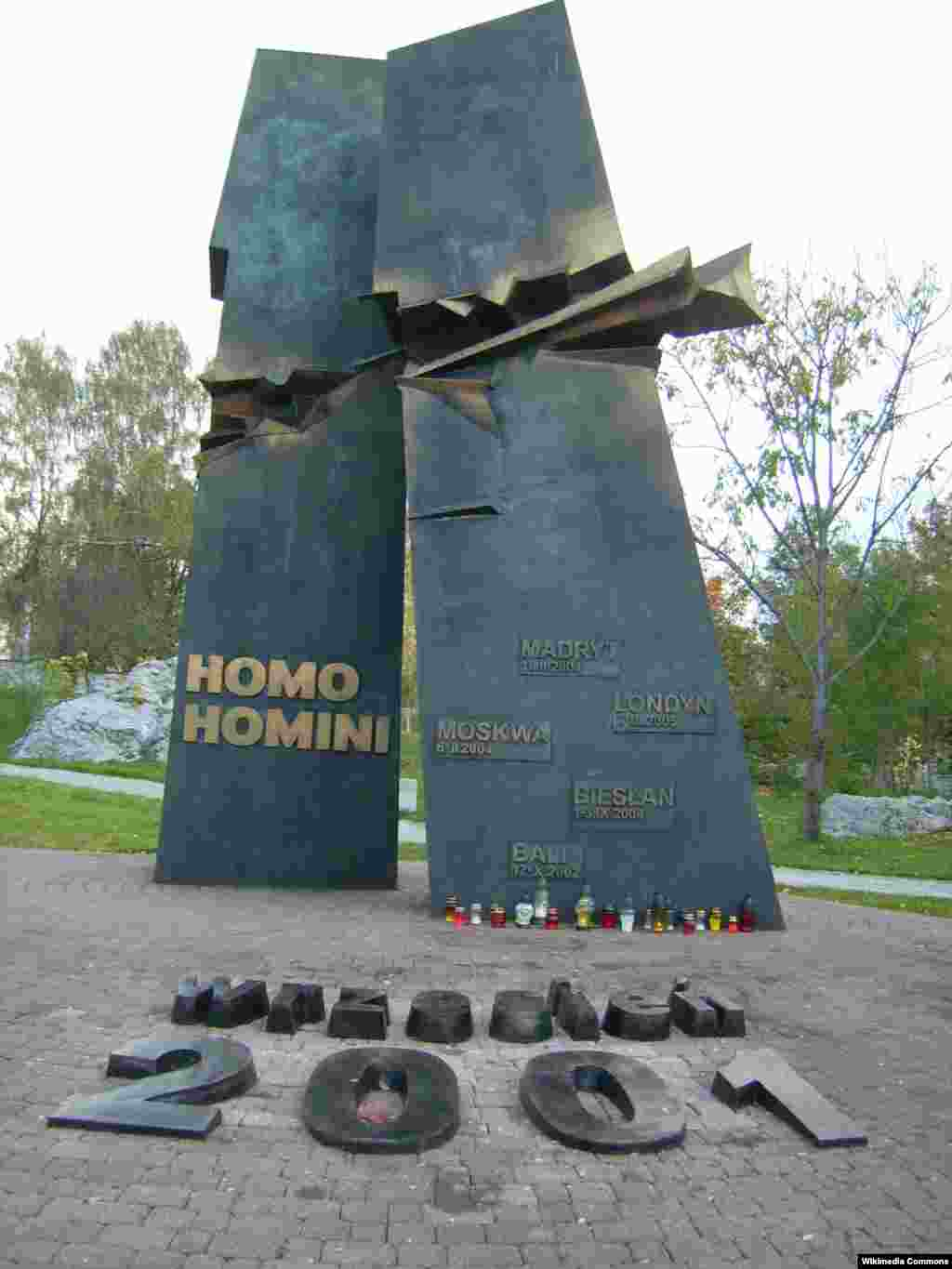 "A memorial to the victims of the attacks in Kielce, Poland, is titled Homo Homini, Latin for ""Man to Man."" The names of other major terrorist attacks of the past 15 years are inscribed on the monument representing the Twin Towers."
