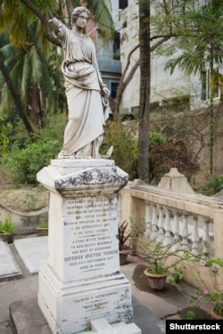 """A tombstone in Armenian and English from 1877 on the church grounds carries a tribute from """"a fond wife"""" to her """"best of husbands."""""""