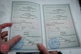 Palazhanka shows her marriage certificate on December 26.