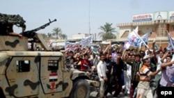 Эксперты объясняют потепление отношения к США в мире некоторой стабилизацией в Ираке