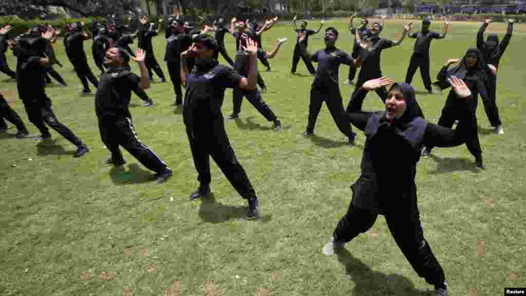 Members of the Pakistani police commando take part in an exercise session at police lines in Lahore. (Reuters/Mohsin Raza)