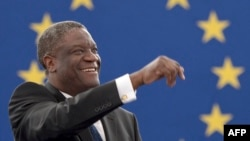 France -- Congolese gynaecologist, specialised in treating victims of rape and extreme sexual violence, Denis Mukwege reacts after receiving the prestigious Sakharov human rights prize at the European Parliament in Strasbourg, November 26, 2014