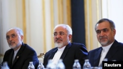 Iranian Foreign Minister Mohammad Javad Zarif (center), Iranian Atomic Energy Organization chief Ali Akbar Salehi (left), and Hossein Fereydoon, brother and close aide to President Hassan Rohani, in Vienna during a meeting with U.S. Secretary of State John Kerry.