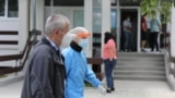 Kosovo: A man wearing a mask is seen near the Clinical Center in Kosovo.