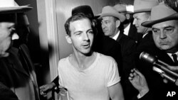 Experts had believed the new JFK files would reveal more about the movements of his presumed assassin, Lee Harvey Oswald (pictured), in the months before the killing took place in November 1963. (file photo)