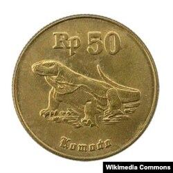 Комод «ажыдаарынын» сүрөтү чегилген Индонезия рупийинин монетасы.