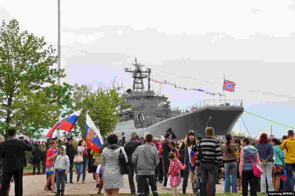 The ship Kaliningrad, part of the Russian Black Sea Fleet, lands in Kerch, Crimea, during Victory Day celebrations.