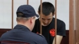 Anarbek Chingiz attends a court hearing on his detention in Moscow on June 18.