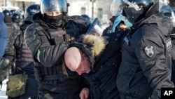 Police detain a man during a protest against the jailing of opposition leader Aleksei Navalny in Khabarovsk on January 23.