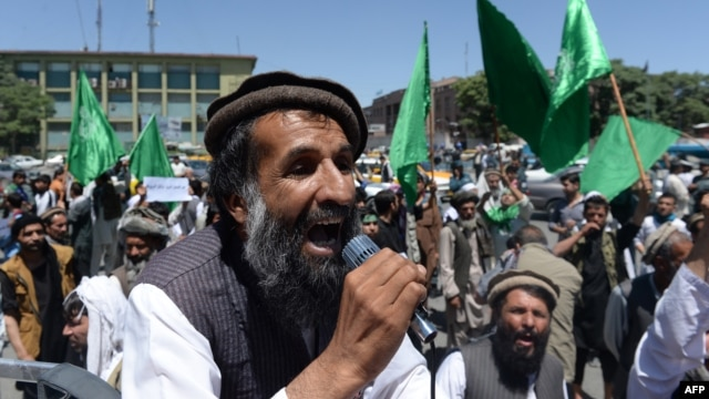 An Afghan demonstrator shouts slogans in support of presidential candidate Abdullah Abdullah in Kabul on June 22. With allegations of fraud circulating, some lawmakers feel social media may be fanning the flames of tension surrounding the hotly contested election.