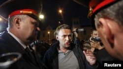 Blogger and activist Aleksei Navalny talks to police officers during a rally in central Moscow on May 8.