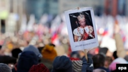 A placard showing Russian President Putin in a dress of Russian tsar during a memorial march for Boris Nemtsov to mark the murder's first anniversary, in Moscow, February 27, 2016