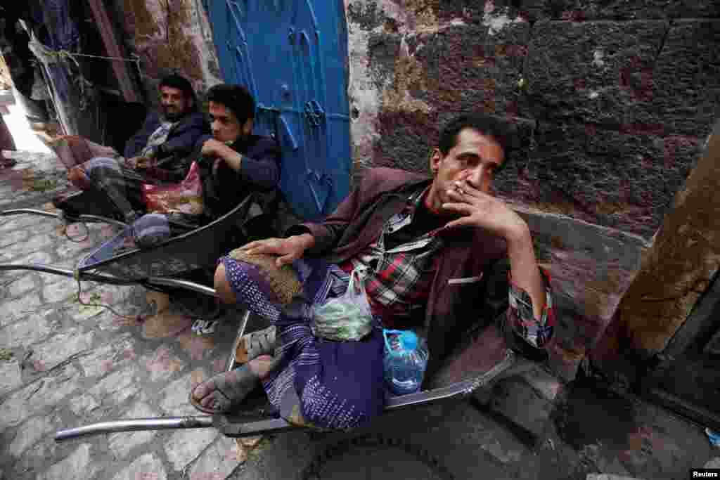 Men rest as they smoke and chew qat, a stimulant, in the old market in Sanaa, Yemen. (Reuters/Mohamed al-Sayaghi)