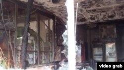 Razbijeni prozori na albanskoj trgovini