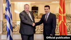 Macedonia Prime Minister Zoran Zaev (right) with Greek Foreign Minister Nikos Kodzias in August