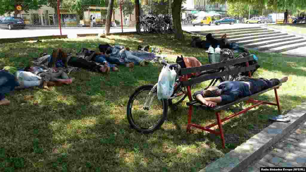 Migrants from Syria rest in a city park. Some have bought bicycles in Macedonia to continue with the next leg of their journey.