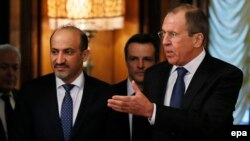 Russian Foreign Minister Sergei Lavrov (right) with the head of the Syrian National Coalition of Opposition and Revolutionary Forces, Ahmad al-Jarba, in Moscow on February 4.