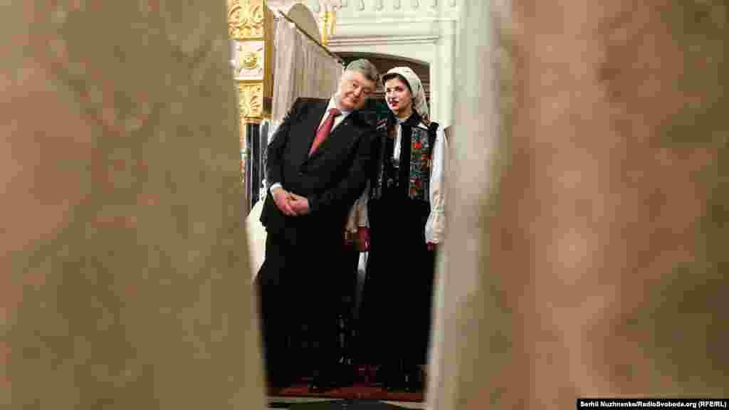 President Poroshenko and his wife Maryna observe the ceremony.