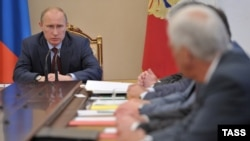 President Vladimir Putin chairs a meeting of Russia's Security Council in the Kremlin on July 6.