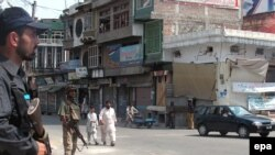 Soldiers stand guard on astreet in Mingora, in the Swat Valley.