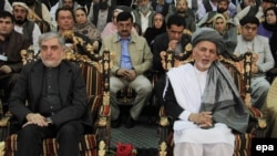 Afghanistan -- Afghan President Ashraf Ghani (R) and Chief Executive Abdullah Abdullah (L) meet the families of the victims of a suicide bomb attack in Jalalabad, April 23, 2015