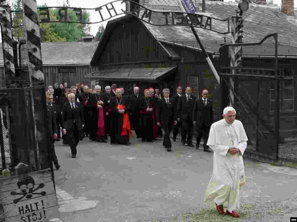 Pope Benedict passes through the gate of the Nazi concentration camp of Auschwitz in Poland in May 2006.