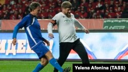 "CHECHNYA -- Chechen leader Ramzan Kadyrov (R) plays during a soccer match between the team"" Leader ""and the team of veterans of Italy in honor of the birthday of the Russian President Vladimir Putin in Grozny, October 7, 2017"
