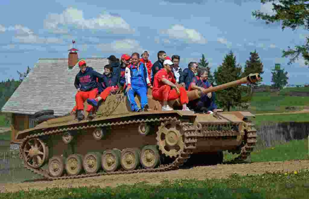 The Russian national ice-hockey team sits atop a tank during their visit to the Military History Museum of the Great Patriotic War near Minsk on May 15. (RIA Novosti/Grigory Sokolov)