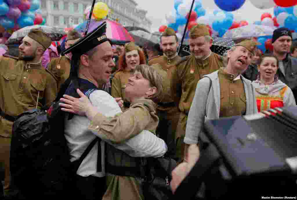 A couple dressed in historical military uniforms dances during May Day celebrations in central Moscow on May 1. (Reuters/Maxim Shemetov)