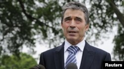 NATO Secretary-General Anders Fogh Rasmussen speaks with reporters after meeting with President Barack Obama at the White House in Washington on May 9.