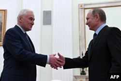 Russian President Vladimir Putin (right) meets with South Ossetia's Leonid Tibilov at the Kremlin in Moscow on March 21.
