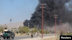 FILE: Smoke rises from the site of an attack in Gardez, the capital of southeastern Paktia Province.