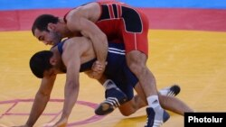 Armenia's Arsen Julfalakian (top) competes in the men's 60 kg semifinals of the Greco-Roman wrestling at the London Olympics in August.